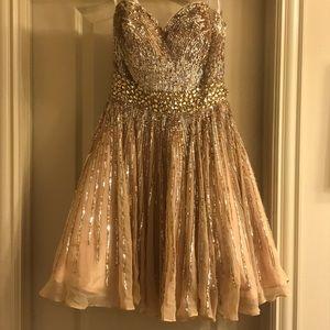 Sherri Hill prom dress in gold